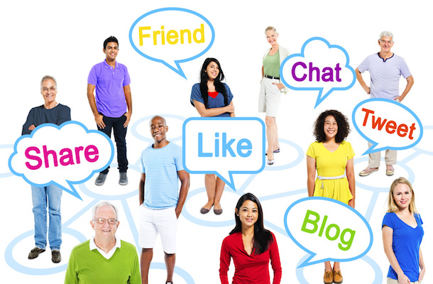 Group Of Multi-Ethnic People In A Connection Themed Picture With Speech Bubbles With Social Networking Themed Words.